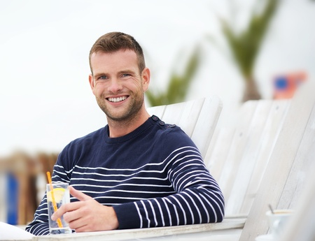 Portrait of a handsome young man enjoying life outdoors photo