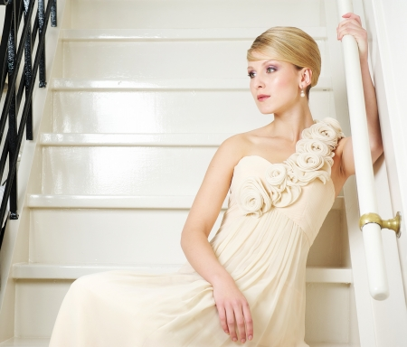 Portrait of an elegant bride sitting on stairs photo