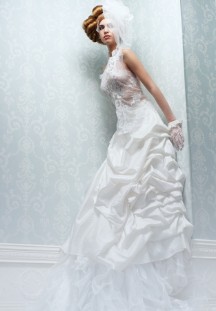 Beautiful tall bride with long white wedding dress and veil