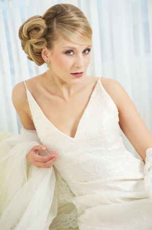 Close up portrait of a beautiful bride in white dress photo