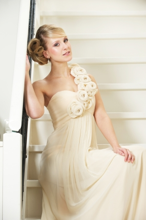 Portrait of a beautiful bride sitting on stairs Stock Photo - 17662624