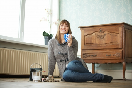 Smiling girl relaxing at home with a cup of tea photo