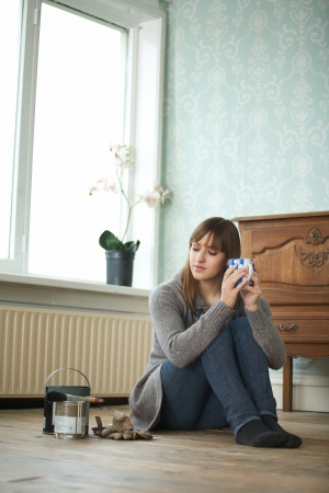 Woman renovating and relaxing with a cup of tea photo