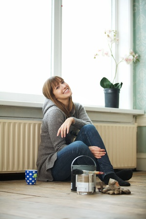 renovating: Smiling woman renovating and relaxing at home Stock Photo