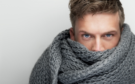 Close up portrait of an attractive face covered by scarf photo