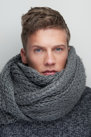 young man short hair: Close up portrait of a handsome man with wool scarf Stock Photo