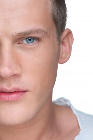 primer plano cara: Half face close up retrato de un joven handseom Foto de archivo