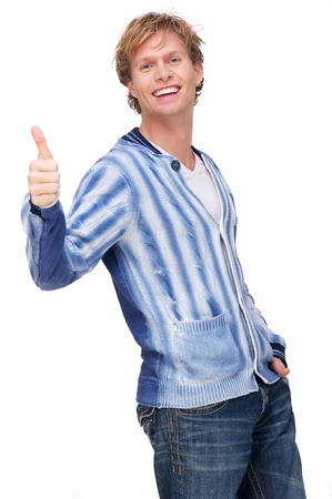 Portrait of a young man with thumbs up photo