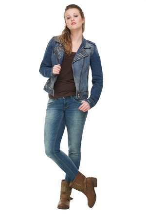 Portrait of a young woman holding jeans jacket Stock Photo - 18236621