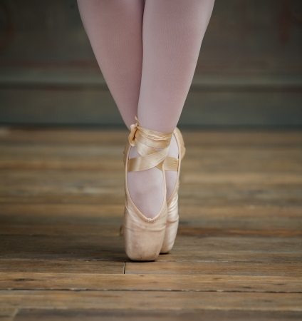 Close up view of a elegant ballerina standing on toes photo