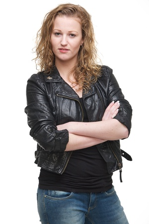 Portrait of a young woman in leather jacket with arms crossed photo