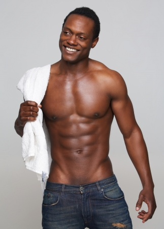 african american nude: Portrait of a sexy african american man smiling Stock Photo
