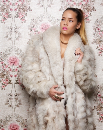 Portrait of a sexy woman in fur coat