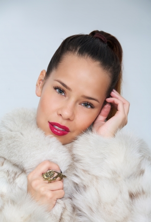 Portrait of a beautiful woman in fur coat photo