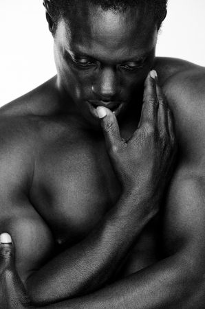 african american nude: Athletic African American man with arms crossed