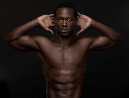 african american nude: Portrait of a sexy African American man with hands to head
