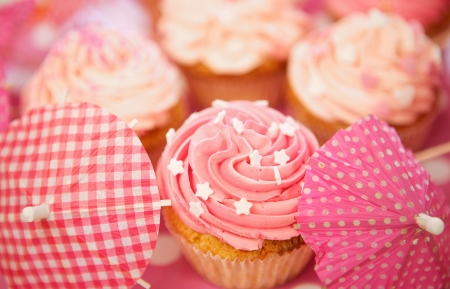 Close up cupcakes decorated with sprinkles, frosting and assortments Stock Photo - 18561150
