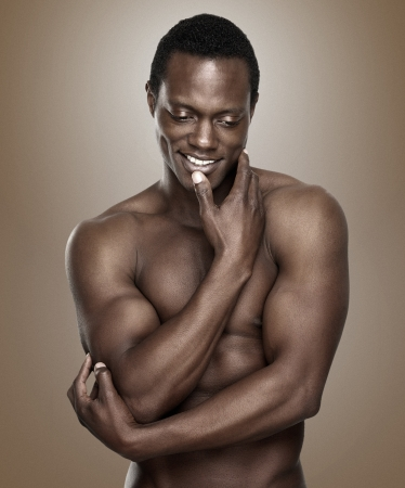 nude fashion model: Portrait of an athletic african american man smiling