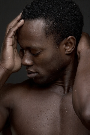 Portrait of a sexy african american man looking away - close up photo