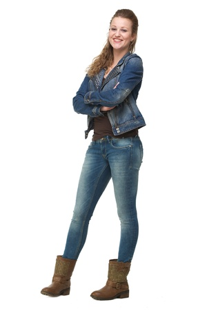 Portrait of a young woman in jeans with arms crossed photo
