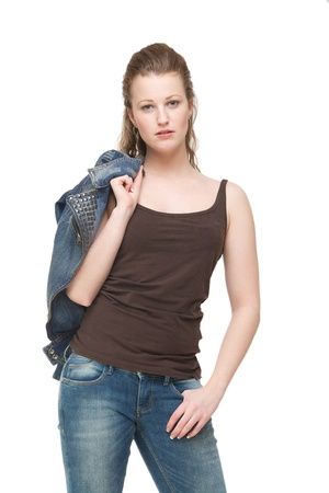 Portrait of a young woman with jeans jacket over shoulder photo