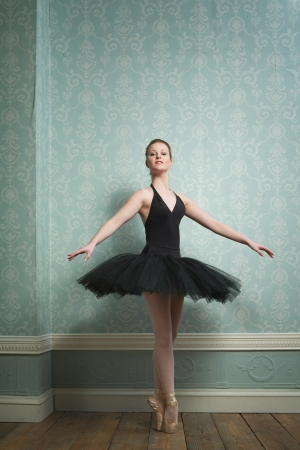 Portrait of a beautiful ballerina in dance pose photo