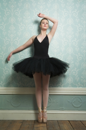 Portrait of a beautiful ballerina standing on toes photo