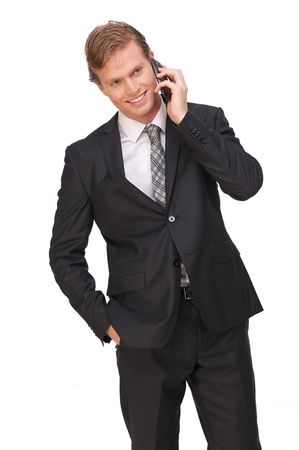 Portrait of a businessman on mobile phone photo