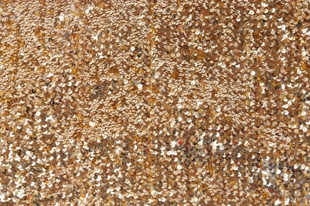 Close up of many shiny gold sequins   photo