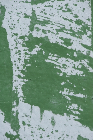 are grazed: Green wall with white paint scraped texture Stock Photo
