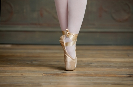 ballerina costume: Close up view of a ballerina standing on toes