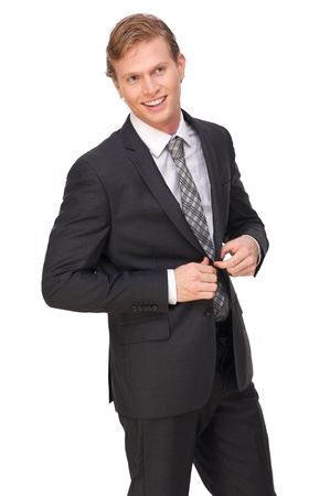buttoning: Portrait of a businessman buttoning suit jacket