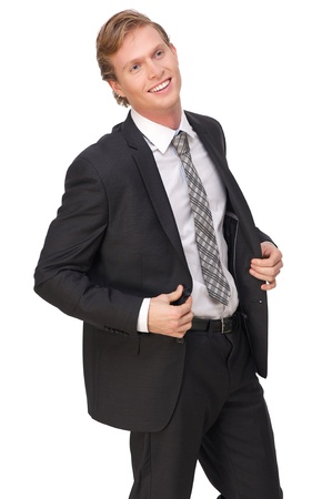 Portrait of a young businessman smiling in black suit photo