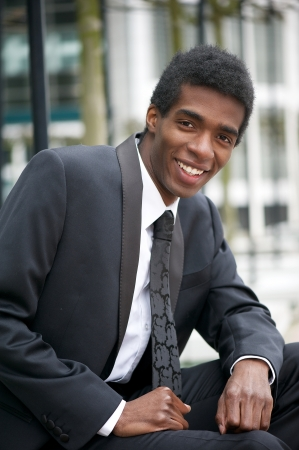 Portrait of a handsome young african american businessman smiling photo