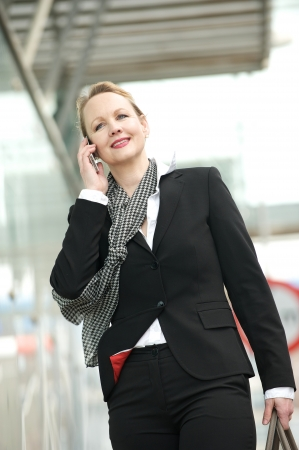 Portrait of a professional business woman on the phone outdoors photo