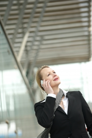 Portrait of a mature woman talking on a cellphone outdoors photo