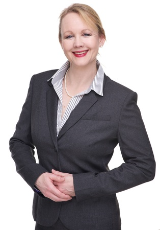 Portrait of a friendly business woman smiling isolated on white photo