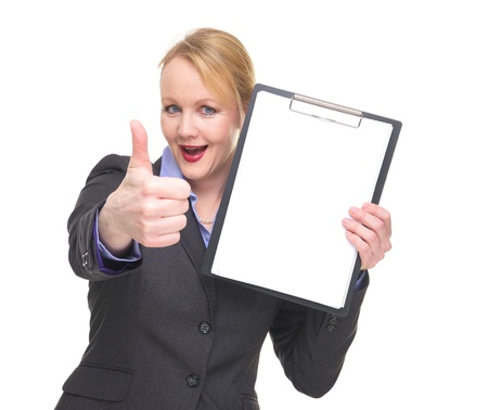 Portrait of a confident businesswoman showing empty sign clipboard isolated on white photo