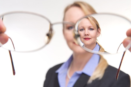people looking up: Portrait of a businesswoman trying on glasses Stock Photo
