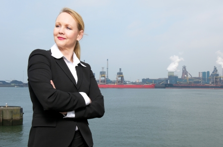 Portrait of a businesswoman standing outside industrial site  photo