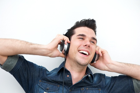Close up portrait of a smiling man listening to music on headphones photo