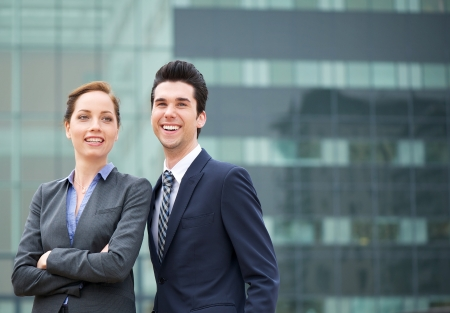Close up portrait of a businessman and business woman smiling  photo