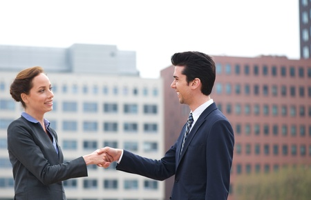Portrait of a businessman and business woman handshake greeting photo