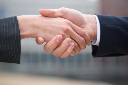 shake hands: Businessman and business woman handshake close up Stock Photo