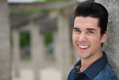 and the horizontal man: Horizontal portrait of a young man smiling outdoors