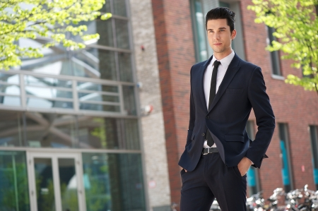 good looking man: Portrait of a handsome businessman walking to work  Stock Photo