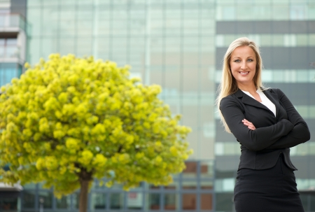 Portrait of a happy business woman smiling outdoors photo