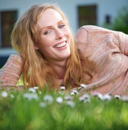 Close up portrait of a happy young woman relaxing outdoors photo