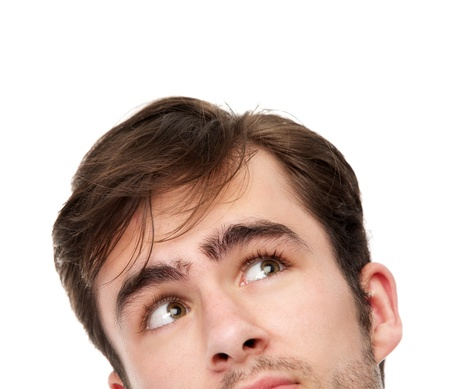 stubble: Close up portrait of a young man looking up