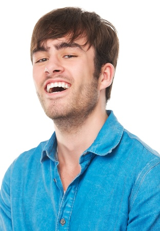 Close up portrait of a young man laughing, isolated on white photo